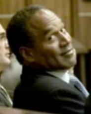 What is OJ Simpson's expression during his trial?